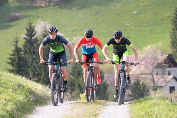Three Mountainbikers riding up a hill