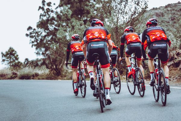Athletes of the team Leeze wearing DOWE Teamwear and cycling on Mallorca