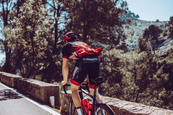 Athlete of the team Leeze wearing DOWE Teamwear and cycling on Mallorca