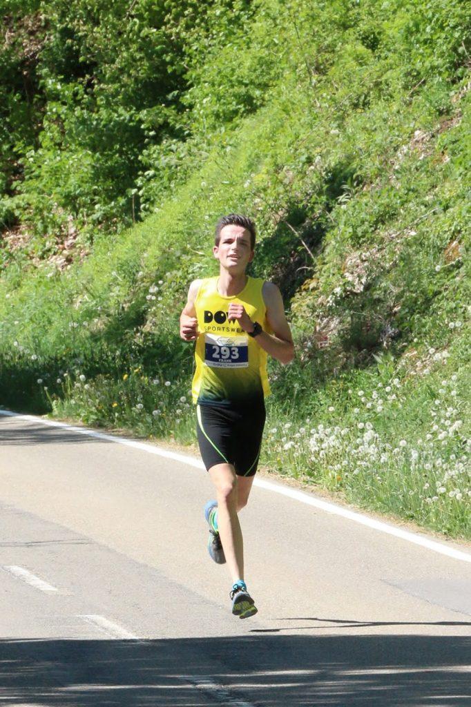 Athlete Frank Knupfer running on road