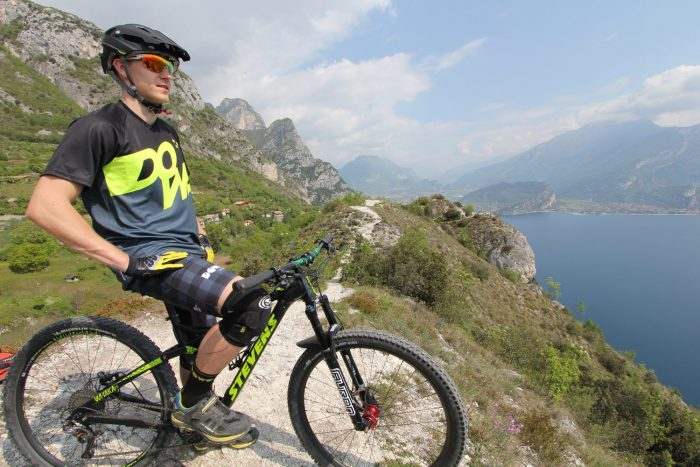 "Model on bike with DOWE MTB / Enduro Short-Sleeve Jersey ""New Fluo"""