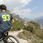 "Model on Bike with MTB / Enduro Short-Sleeve Jersey ""New Fluo"" - near Lake Garda"